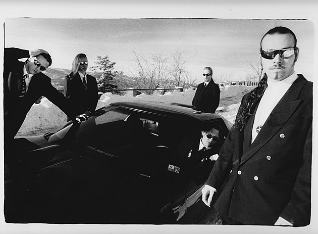 An alternate take from the shoot which yielded the infamous 'Car and Suits' promotional photo, early 1997